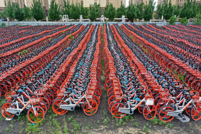 Aerial view of shared bikes piled up at a parking lot on June 9, 2020 in Shenyang, Liaoning Province of China. (Photo by VCG/VCG via Getty Images)