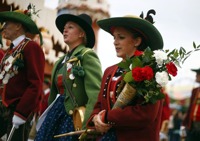 People dressed in traditional Bavarian clothes take part in the Oktoberfest parade in Munich, Germany, September 20, 2015. (Photo by Michael Dalder/Reuters)r