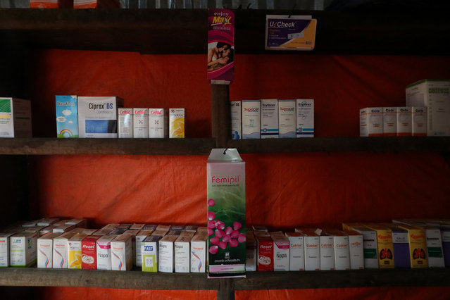 "Femipil and other medicines are displayed for sale in a pharmacy in Palong Khali refugee camp near Cox's Bazar, Bangladesh, October 30, 2017. Bangladeshi trader Mohammed Yusuf, 18, started trading three days ago. He sells Femipil at 18 taka per packet. ""My prices are similar to that of all over Bangladesh. I just sell products which have fixed prices on them. Rohingya refugees don't know the price of medicine, most of them are uneducated thats why they are saying the prices are too high for them"", he said. (Photo by Hannah McKay/Reuters)"