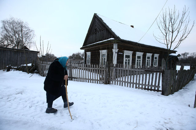 "Just a few hours' drive from the Belarus capital of Minsk, many villagers still live off the land. Nearly 80% of the country's 9.5 million citizens live in urban areas, but for the rest, being close to nature can outweigh the hardships of country life. Here: Ekaterina Panchenya, 75, walks in the snow to her neighbour's house, in the village of Pogost, Belarus. ""I do everything myself: feed the animals in the barn, the chickens in the yard. The river is nearby, the forest, mushrooms and berries in the summer. No, I'll never in my life move to town"", she said. (Photo by Vasily Fedosenko/Reuters)"