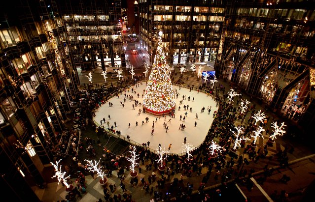 Skaters take to the ice around the Christmas tree at PPG Place on Light Up Night in downtown Pittsburgh. (Photo by Stephanie Strasburg/Tribune-Review)