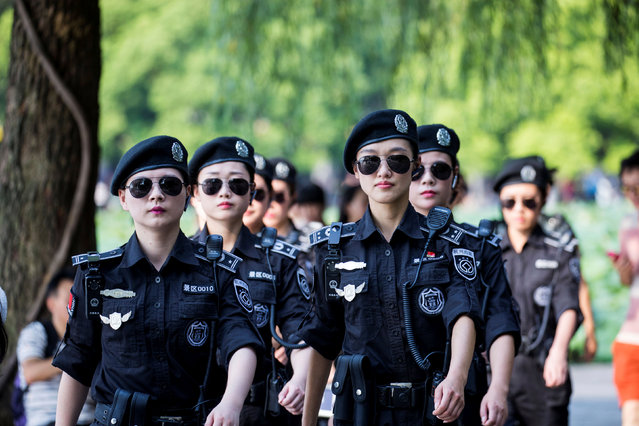 Security personnel patrol around West Lake in Hangzhou, Zhejiang Province, China, August 31, 2016. (Photo by Reuters/Stringer)
