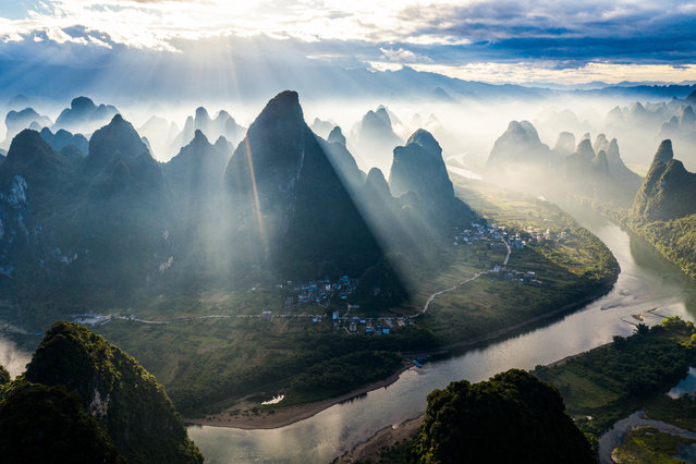 Dawn breaks over the Li River and Xianggong mountain in Guilin, China at 4:30 in the morning of August 1, 2020. (Photo by Sipa Asia/Rex Features/Shutterstock)