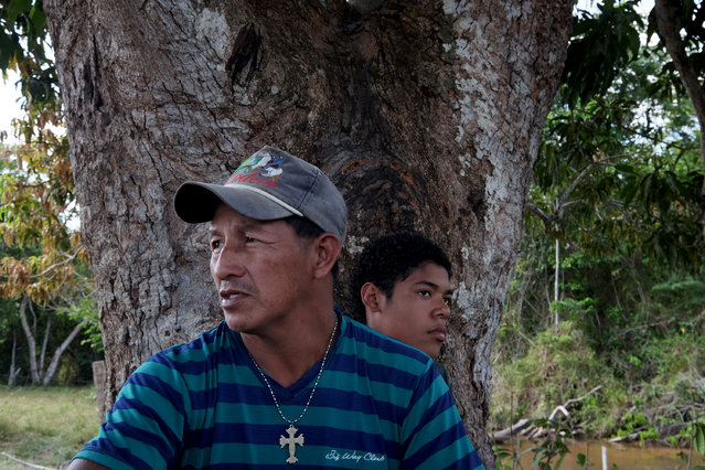 "Valdirmani Guajajara, 42, foreground, near Cigana Village in Araribóia Indigenous Reserve, Maranhão, Brazil on August 8, 2015. He  said that loggers ""pay a percentage to pass over our bridge.""  He was critical of the Guardians of the Forest and said ""They (Guardians) have to reach a deal with these people with goodwill. Not everybody likes pressure"". (Photo by Bonnie Jo Mount/The Washington Post)"