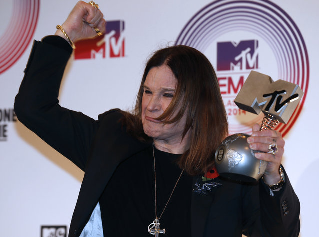 Ozzy Osbourne poses with his Global Icon award during the 2014 MTV Europe Music Awards at the SSE Hydro Arena in Glasgow. (Photo by Russell Cheyne/Reuters)