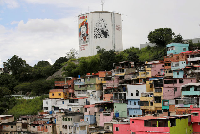 A general view of the neighbourhood, 23 de Enero, is seen next to an image of Venezuela's late President Hugo Chavez, in Caracas, Venezuela September 8, 2016. (Photo by Henry Romero/Reuters)