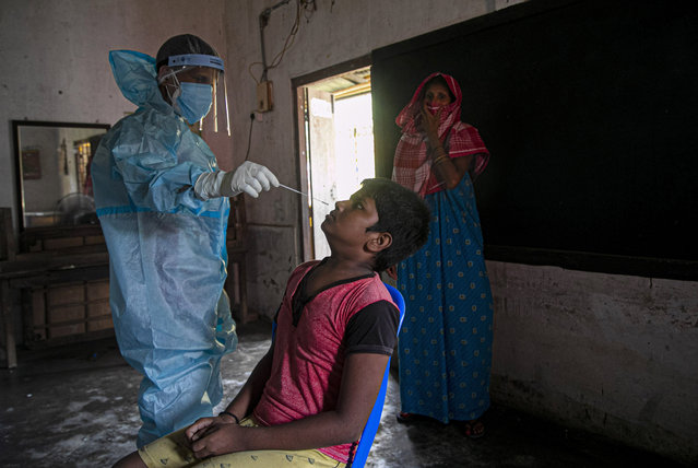 A health worker takes a nasal swab sample to test for COVID-19 in Gauhati, India, Thursday, September 10, 2020. India reported another record spike of 95,735 new coronavirus infections in the past 24 hours as the virus spreads beyond its major cities. The ministry said the surge in new infections is due to ramping of daily testing that exceeds 1 million now. However, experts caution that India's outbreak is entering a more dangerous phase as the virus spreads to smaller towns and villages. (Photo by Anupam Nath/AP Photo)