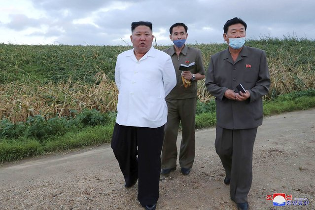 "In this undated photo provided on Friday, August 28, 2020, by the North Korean government, North Korean leader Kim Jong Un, left, visits a western coastal area in South Hwanghae province, North Korea, where Typhoon Bavi made landfall early Thursday, Aug. 27. Independent journalists were not given access to cover the event depicted in this image distributed by the North Korean government. The content of this image is as provided and cannot be independently verified. Korean language watermark on image as provided by source reads: ""KCNA"" which is the abbreviation for Korean Central News Agency. (Photo by Korean Central News Agency/Korea News Service via AP Photo)"