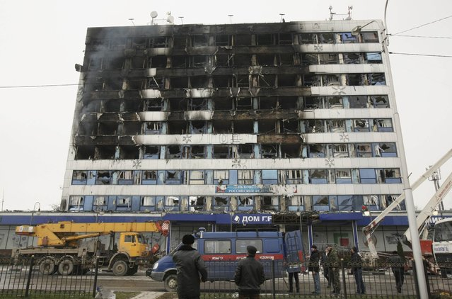 The burnt exterior of the Press House, a local media agency, is seen in the Chechen capital Grozny, December 4, 2014. At least six gunmen and three policemen were killed in gun battles in which a building was stormed in the Chechen capital Grozny on Thursday, the leader of the turbulent southern Russian region said. (Photo by Reuters/Stringer)