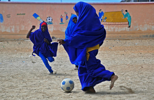 Somali school girls play football during lunch break at the Howlwadag Primary School in Howlwadag District, south of Mogadishu, on October, 5, 2016. (Photo by Mohamed Abdiwahab//AFP Photo)