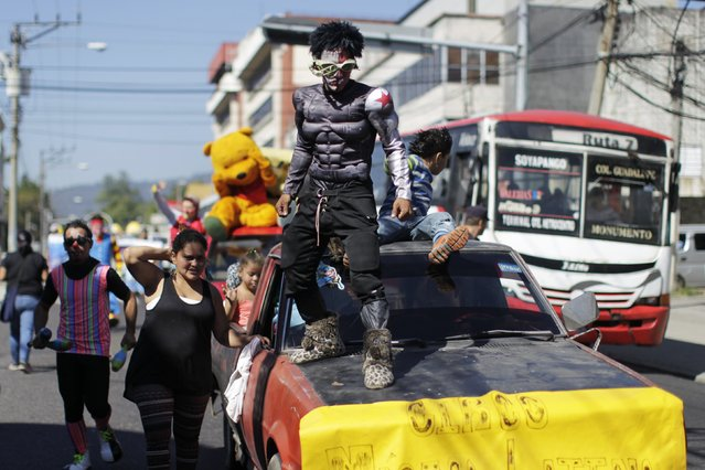 A circus perfomer participates in a parade to celebrate the circus performer's day in San Salvador December 16, 2014. (Photo by Jose Cabezas/Reuters)