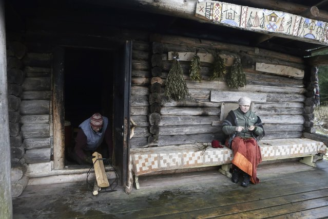 Smoke rises from the sauna as Urmas Veeroja and his wife Eda prepare for bathing at Mooska farm, near the village of Haanja December 20, 2014. (Photo by Ints Kalnins/Reuters)