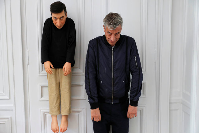 "Italian artist Maurizio Cattelan poses with his creation ""La Rivoluzione Siamo Noi"" (2000) prior to the opening of the exhibition ""Not Afraid of Love"" at the Hotel de la Monnaie in Paris, France, October 17, 2016. (Photo by Philippe Wojazer/Reuters)"