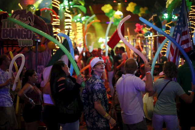 Tourists dance at a nightclub in Cancun, October 12, 2015. In the high season from about December to early April, tourists from the United States, Europe and further afield crowd the resort to swim and snorkel off usually pristine white beaches, party in the resort's many nightclubs and play golf. (Photo by Edgard Garrido/Reuters)
