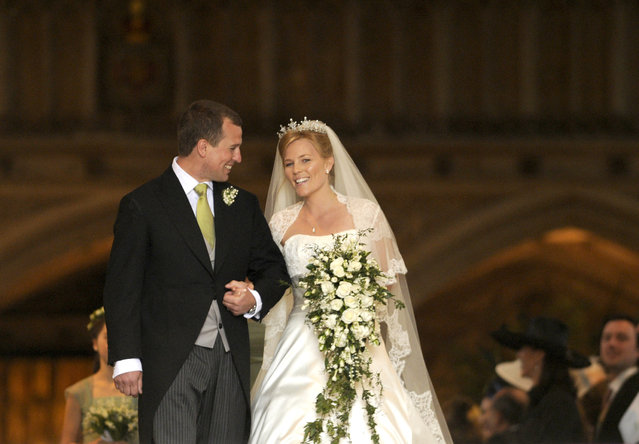 Britain's Peter Phillips and Canada's Autumn Kelly leave St George's Chapel after their marriage in Windsor, southern England, May 17, 2008. Peter Phillips became the first of Queen Elizabeth's grandchildren to wed, marrying his Canadian bride in drizzly weather at a chapel at the queen's Windsor Castle residence near London. (Photo by Ian McIlgorm/Reuters/Pool)