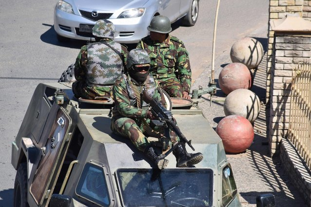 """Lesotho Defense Force patrols the town of Maseru on April 18, 2020. Lesotho's embattled prime minister Tom Thabane announced on Saturday he had sent troops onto the streets to """"restore order"""", accusing unnamed law enforcement agencies of undermining democracy. (Photo by Molise Molise/AFP Photo)"""