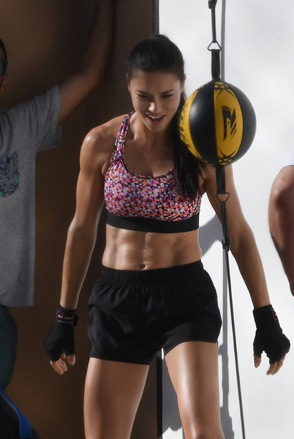 Adriana Lima shows off her boxing skills and impressive abs on the set of a Victoria's Secret Sport photo shoot in Miami on October 21, 2016. The 35 year old mother of two put the boxing ball through it's paces as she glistened with sweat. (Photo by Thibault Monnier/Pacific Coast News)