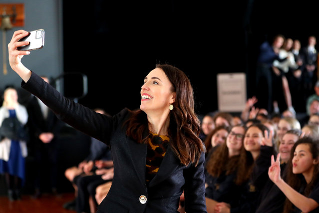 New Zealand Prime Minister Jacinda Ardern takes a selfie with students at Northcote College on July 03, 2020 in Auckland, New Zealand. Prime Minister Jacinda Ardern and Education Minister Chris Hipkins have announced a new nationwide school redevelopment programme to upgrade schools over the next 10 years. The first phase of the National School Redevelopment Programme will see up to $1.3 billion invested to improve up to 40 schools across New Zealand. (Photo by Hannah Peters/Getty Images)