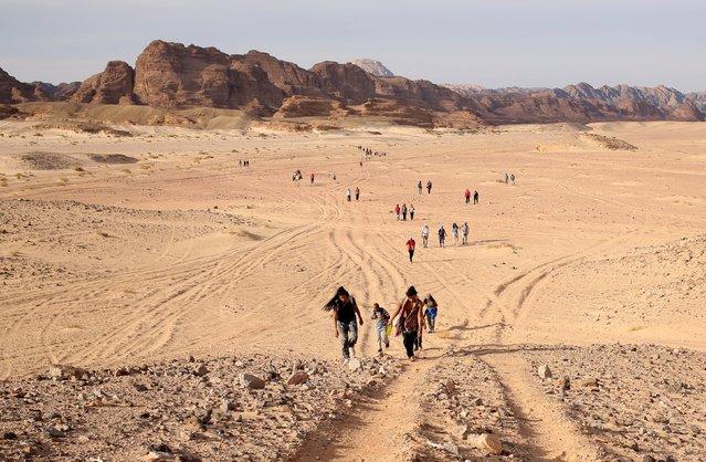 Hikers walk through the Wadi Hudra area near Ras Ghazala, South Sinai, Egypt, November 21, 2015. (Photo by Asmaa Waguih/Reuters)