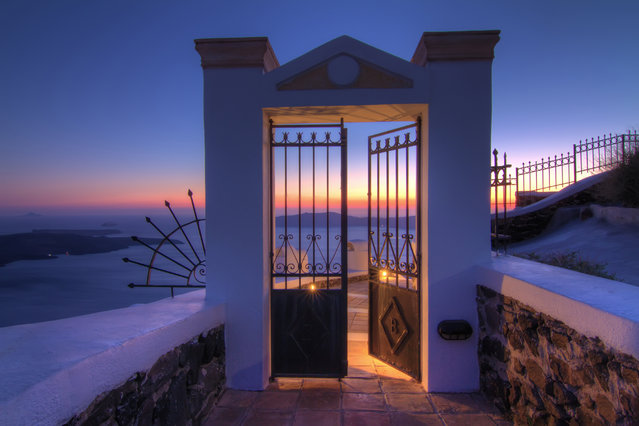 """Gate to Heaven"". Santorini is essentially what remains after an enormous volcanic explosion. It is now a famous tourist attraction due to its magic sunsets by & dramatic cliffs – and the island is especially popular among honeymooners. Location: Santorini, Greece. (Photo and caption by Pål Sundsøy/National Geographic Traveler Photo Contest)"