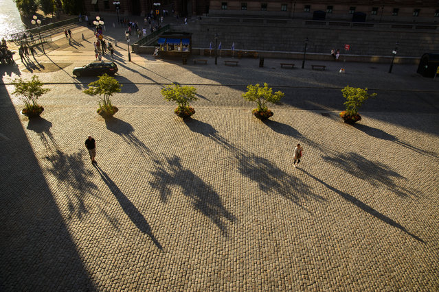 """Long Shadows in Stockholm"". Sunset on a square in Stockholm. Location: Stockholm, Sweden. (Photo and caption by James Kobacker/National Geographic Traveler Photo Contest)"