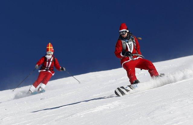 People, dressed as Santa Claus, take a curve during a promotional event on the opening weekend in the alpine ski resort of Verbier, Switzerland, December 6, 2015. (Photo by Denis Balibouse/Reuters)