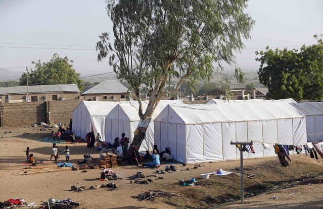 People displaced as a result of Boko Haram attacks in the northeast region of Nigeria, are seen near their tents at a faith-based camp for internally displaced people (IDP) in Yola, Adamawa State January 14, 2015. (Photo by Afolabi Sotunde/Reuters)