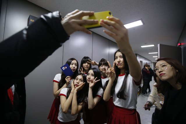 "Members of South Korean girl group GFriend take a ""selfie"" after their performance in ""The Show"" in Seoul January 20, 2015. (Photo by Kim Hong-Ji/Reuters)"