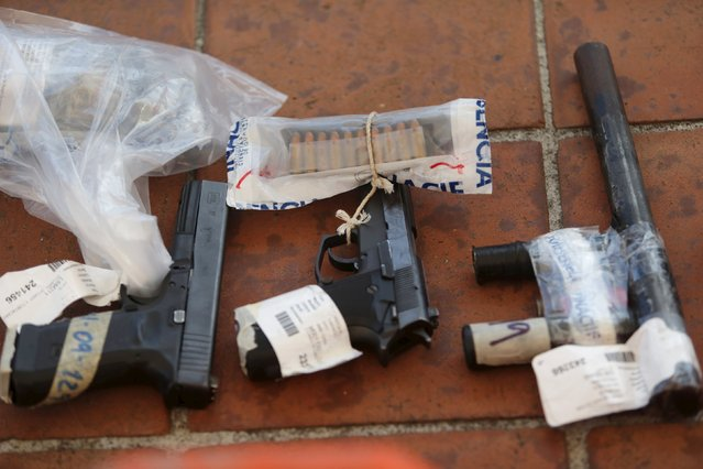 Seized weapons are seen before being destroyed by the authorities of the General Directive for the Control of Weapons and Munitions, (DIGECAM), in Guatemala City, December 17, 2015. (Photo by Jorge Dan Lopez/Reuters)