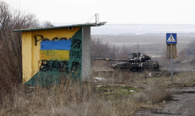 A Ukrainian army vehicle drives through fields near the town of Debaltseve, Ukraine, Monday, February 2, 2015. As fighting intensifies between government and rebel forces for control over a key railway hub in the eastern Ukraine town of Debaltseve, separatist leader Alexander Zakharchenko said Monday that he plans to mobilize enough new volunteers to bring his forces to 100,000 men. (Photo by Petr David Josek/AP Photo)