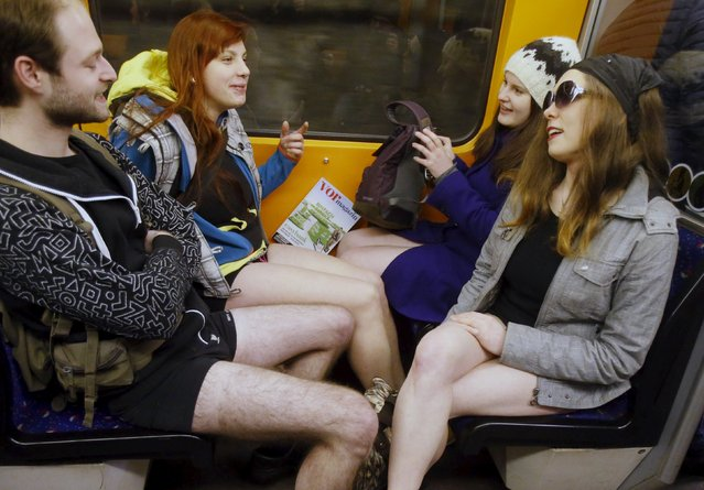 People take part in the 'No Pants Subway Ride' in Vienna, Austria, January 10, 2016. The 'No Pants Subway Ride' is an annual event that has become a global celebration of bare thighs. (Photo by Heinz-Peter Bader/Reuters)