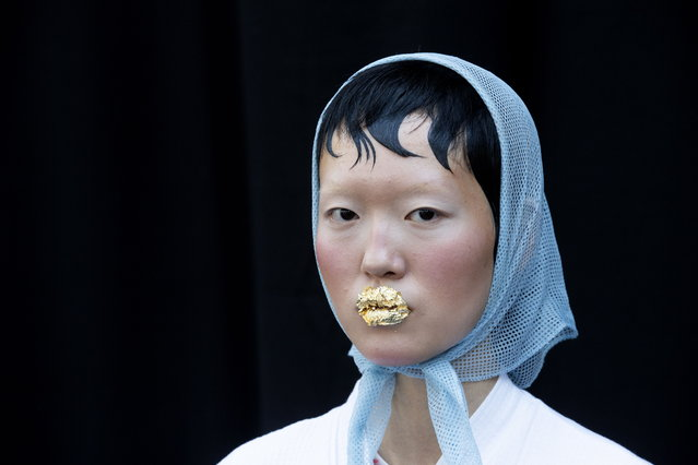 A model is getting ready backstage prior to the Spring/Summer 2019 Women's collections by US designer Thom Browne during the Paris Fashion Week, in Paris, France, 30 September 2018. (Photo by Etienne Laurent/EPA/EFE)