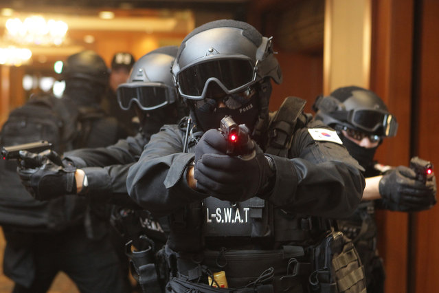 Members of Special Weapons and Tactics team (SWAT) who are employees of Lotte Group, take part in an anti-terror drill at the Lotte Hotel  on January 20, 2016 in Seoul, South Korea. The drill comes amid international concerns about terrorism. (Photo by Chung Sung-Jun/Getty Images)