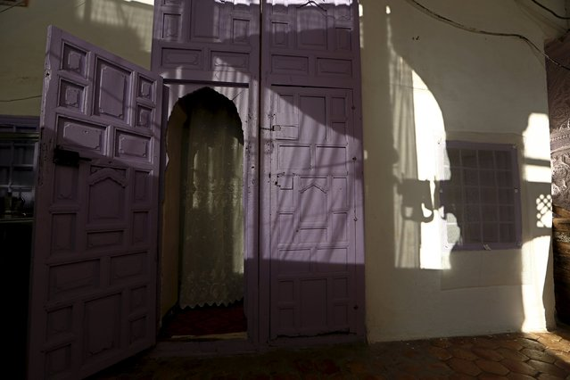 Drying laundry casts a shadow on the wall of a moorish house in the old city of Algiers Al Casbah, Algeria December 13, 2015. (Photo by Zohra Bensemra/Reuters)