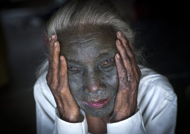 A woman with a rare full-face tattoo. She comes from the Kanpelet village, home to women from the U Pu tribe, in February, 2015, in Myanmar, Burma. (Photo by Eric Lafforgue/Barcroft Media)