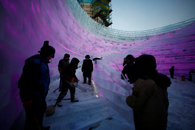 Artists and workers prepare an ice sculpture for the upcoming Harbin International Ice and Snow Sculpture Festival, in Harbin, Heilongjiang province, China, December 16, 2016. (Photo by Aly Song/Reuters)