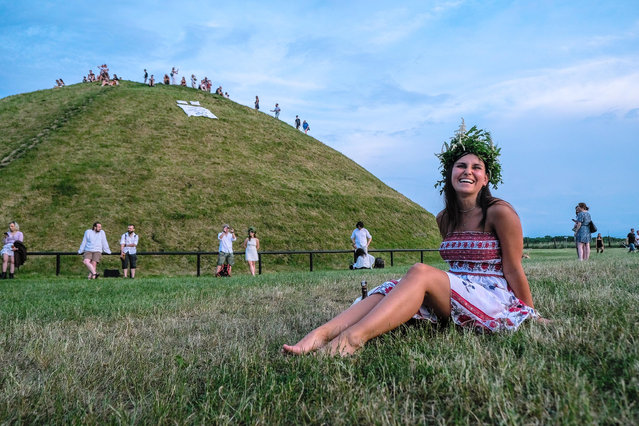 A woman wears a flower crown during a Summer Solstice celebration on June 21, 2021 in Krakow, Poland. The summer solstice represents the longest day of the year, with the most hours of sunlight, and is celebrated by various cultures worldwide. (Photo by Omar Marques/Getty Images)