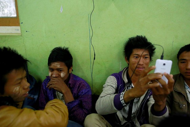 Refugees who fled from violence in Laukkai, Kokang region, pass time at a temporary refugee camp set up in a monastery in Lashio February 19, 2015. (Photo by Soe Zeya Tun/Reuters)