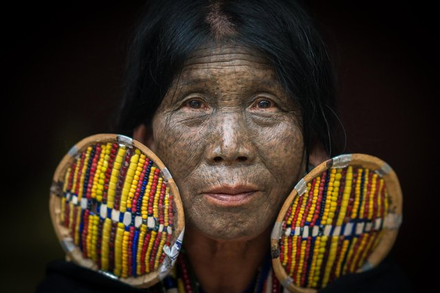 Woman of the Chin tribe showsoff her face tattoos in, Mindat, Myanmar, November 2016. In the mountains of Myanmar lives a tribe where the women have taken a unique approach to their beauty regime by decorating their faces with tattoos. The Chin people in the remote mountain town of Mindat, have been marking women in the area with intricate face tattoos for centuries. With a variety of styles and designs the detailed markings have a deep rooted cultural significance to the largely christian community. Photographer and cyber security expert, Teh Han Lin took the intimate pictures on a recent trip to Myanmar. (Photo by Teh Han Lin/Barcroft Images)