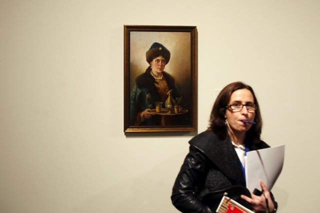 """A woman stands next to """"Boyar's daughter"""" by Russian-born artist Nikolai Nevrev during an international press tour of the Malaga branch of the State Museum of Russian Art of St Petersburg, a day before its inauguration in Malaga, southern Spain March 24, 2015. (Photo by Jon Nazca/Reuters)"""