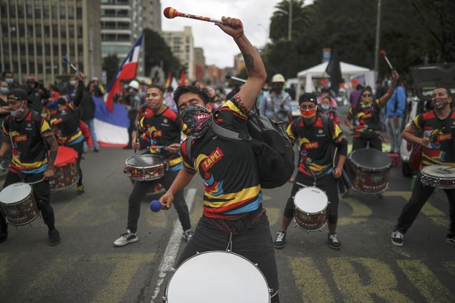 Young men perform in a drumline during an anti-government protest in Bogota, Colombia, Tuesday, July 20, 2021, as the county marks its Independence Day. (Photo by Ivan Valencia/AP Photo)
