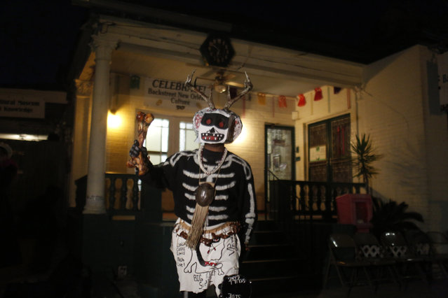 A member of the North Side Skull & Bone Gang, starts the celebration with a wake up call for Mardi Gras at the Backstreet Cultural Museum, Tuesday, February 9, 2016, in New Orleans. (Photo by Brynn Anderson/AP Photo)