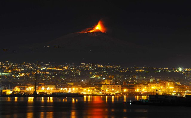Mt. Etna, Europe's tallest active volcano, spews lava during an eruption near the Sicilian town of Catania, Italy, on November 28, 2013.  Etna's eruptions aren't infrequent, the last one occurred on November 23. Its last major eruption was in 1992. (Photo by Salvatore Allegra/Associated Press)