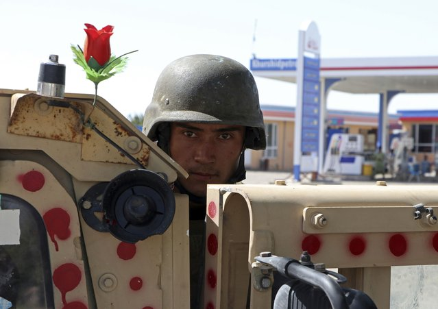 An Afghan army soldier stands guard on the outskirts of Mazar-e-Sharif, Afghanistan, Tuesday, August 10, 2021. (Photo by Mirwais Bezhan/AP Photo)