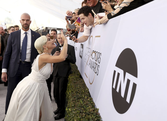 Lady Gaga interacts with fans at the 25th annual Screen Actors Guild Awards at the Shrine Auditorium & Expo Hall on Sunday, January 27, 2019, in Los Angeles. (Photo by Matt Sayles/Invision/AP Photo)