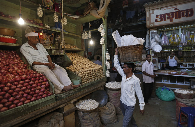 A vendor waits for customers at his stall at a wholesale vegetable and fruit market in Mumbai, India, February 29, 2016. (Photo by Danish Siddiqui/Reuters)