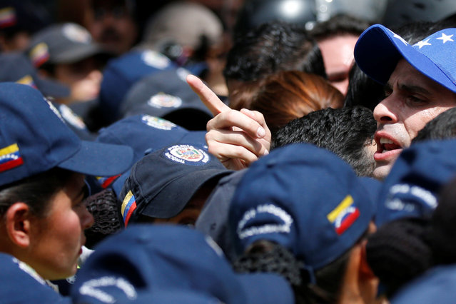 Venezuelan opposition leader and Governor of Miranda state Henrique Capriles (R) takes part in a rally against Venezuelan President Nicolas Maduro's government and to commemorate the 59th anniversary of the end of the dictatorship of Marcos Perez Jimenez in Caracas, Venezuela January 23, 2017. (Photo by Carlos Garcia Rawlins/Reuters)