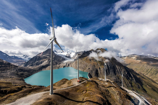 A photograph made available on 30 September 2016 showing wind turbines at the site of the highest wind park in Europe at the Griessee, near the Nufenenpass in the Swiss south Alpes, Valais, Switzerland, on 23 September 2016. The four wind turbines of this wind park were developed by the company SwissWinds GmbH and are inaugurated on, 30 September 2016. (Photo by Olivier Maire/EPA)