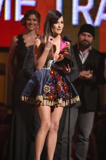 "Kacey Musgraves accepts the award for best country album for ""Same Trailer Different Park"" at the 56th annual Grammy Awards at Staples Center on Sunday, Jan. 26, 2014, in Los Angeles. (Photo by Matt Sayles/Invision/AP)"