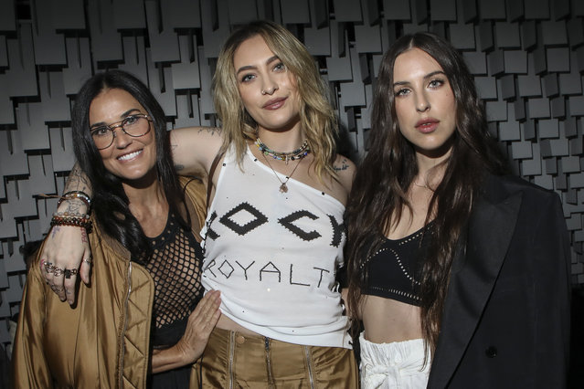 Demi Moore, from left, Paris Jackson and Scout Willis arrive for the Stella McCartney Spring-Summer 2022 ready-to-wear fashion show presented in Paris, Monday, October 4, 2021. (Photo by Vianney Le Caer/Invision/AP Photo)